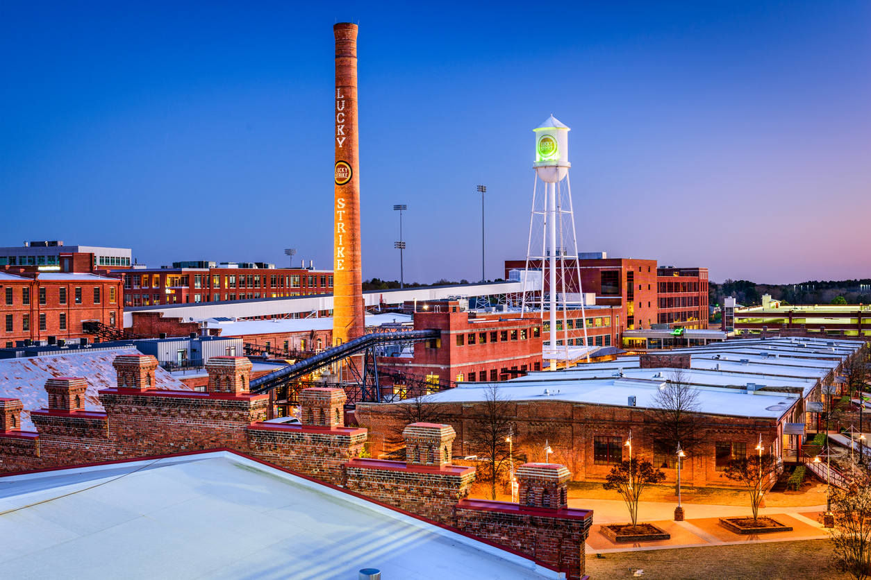 Durham skyline with the Lucky Strikes smokestack and the Durham Bulls water tower.
